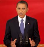 US-Präsident Barack Obama spricht am Rednerpult und gestikuliert mit beiden Händen